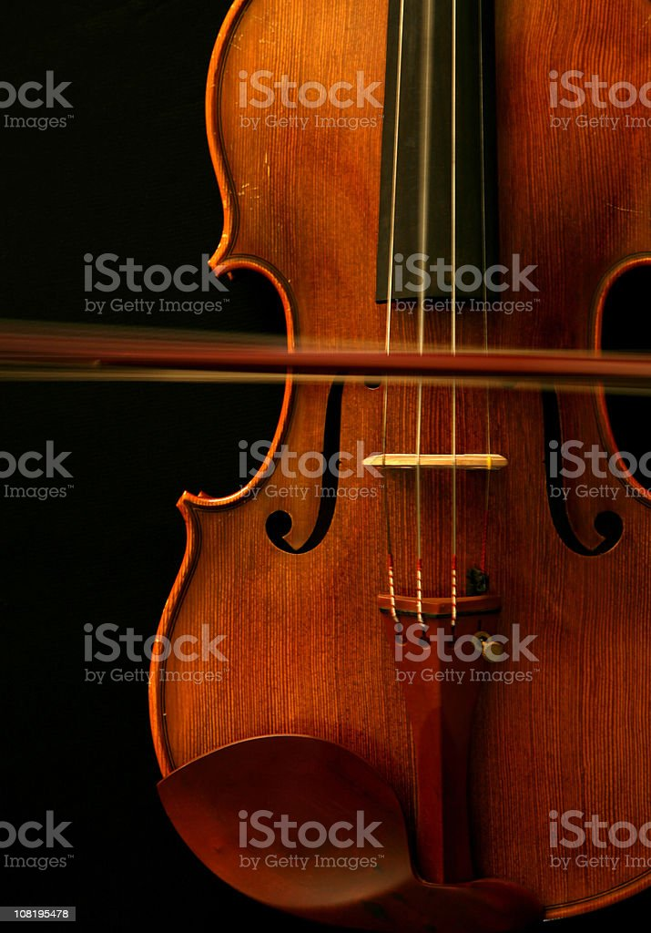 Violin with Moving Bow and Vibrating String royalty-free stock photo