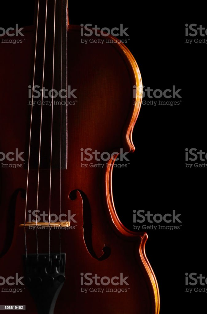 Violin with ragged string, isolated on black stock photo