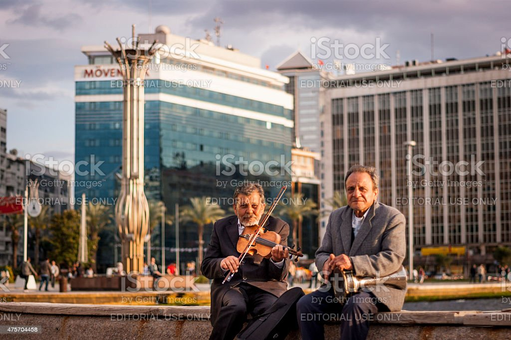 Violinist and tomtom player. stock photo