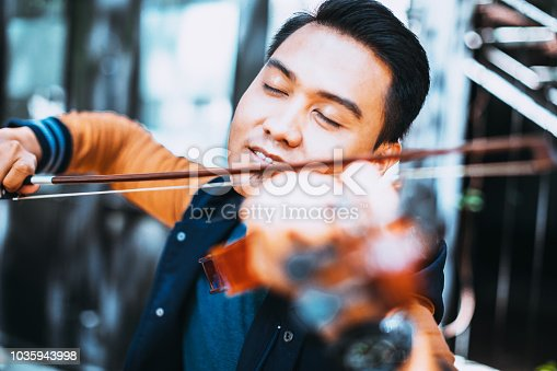 istock Violinist enjoying his art 1035943998