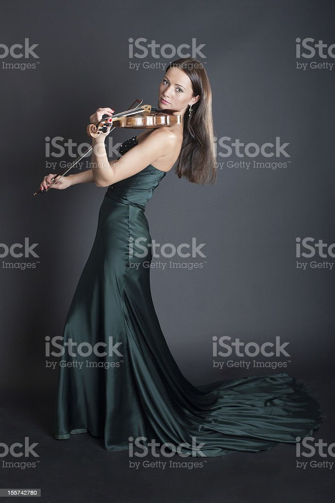 violinist in an evening dress royalty-free stock photo