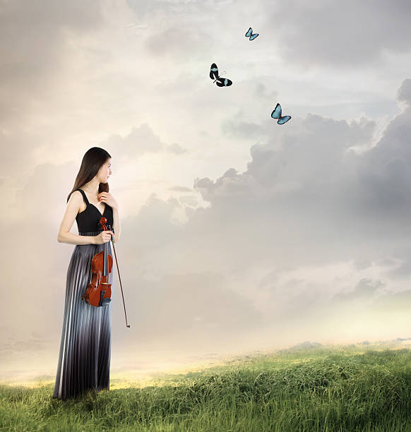 Violinist on a mountain top picture id149130082?b=1&k=6&m=149130082&s=612x612&w=0&h=v6ftysrjfgjl2fy219bxlhwhwnctu98thnrgdi7h2a4=