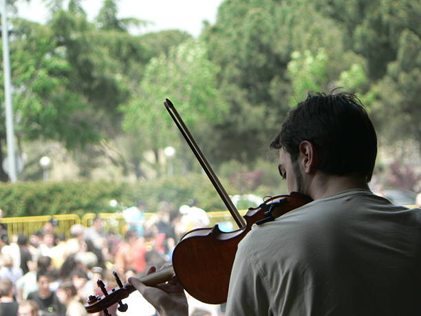 violinist open air concert folk music stock pictures, royalty-free photos & images