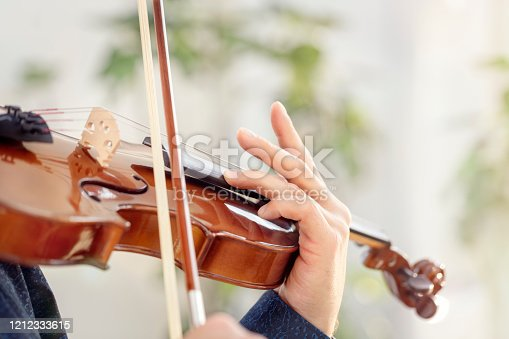 Violinist player musician in orchestra hands playing classical music on violin
