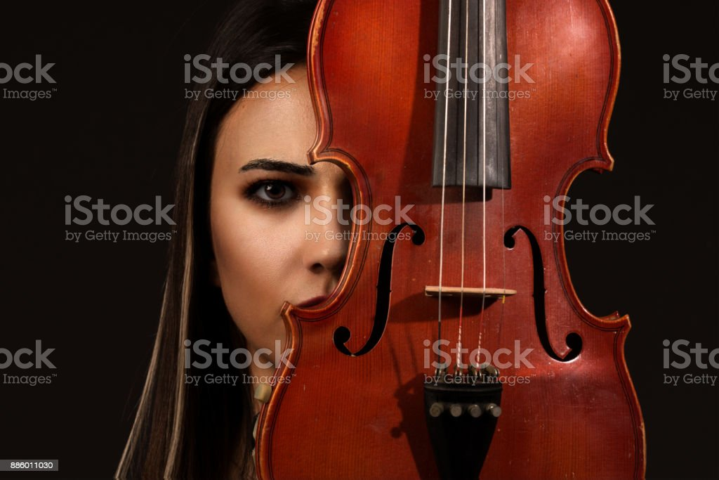 Violinist Woman portrait with violin on background stock photo