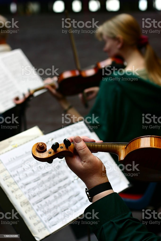 Violinists performing in a concert royalty-free stock photo