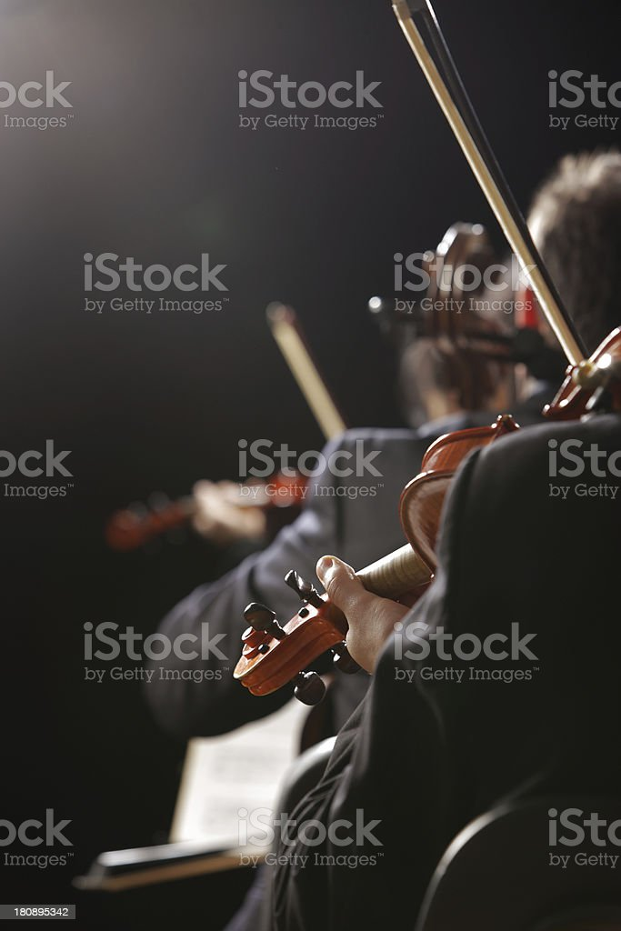 Violinists playing classical music live in concert royalty-free stock photo