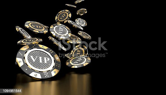 golden and carbon fiber gambling chips on blackbackground
