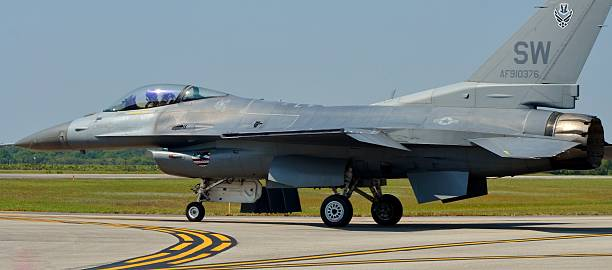 F-16 Viper/Fighting Falcon on a Runway Melbourne, USA - March 21, 2015: An Air Force F-16 Viper/Fighting Falcon taxis down a runway in Melbourne, Florida. The F-16 belongs to the 20th Fighter Wing from Shaw Air Force Base.  f 16 fighting falcon stock pictures, royalty-free photos & images