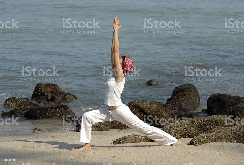 virabhadrasana, hatha yoga by the beach royalty-free stock photo