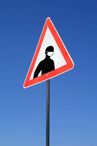 Viral masked man sign warning sign stock photo