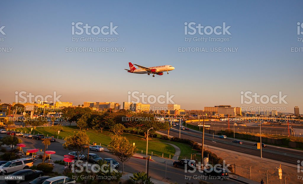 Virgin Atlantic Airplane flying over LAX stock photo