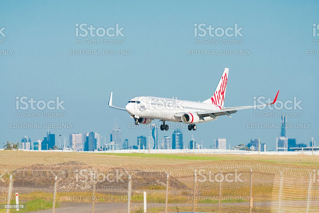 Virgin Australia airplane landing at Melbourne Airport stock photo
