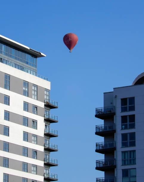 A Virgin hot air baloon drifts over flats in Basingstoke town centre stock photo