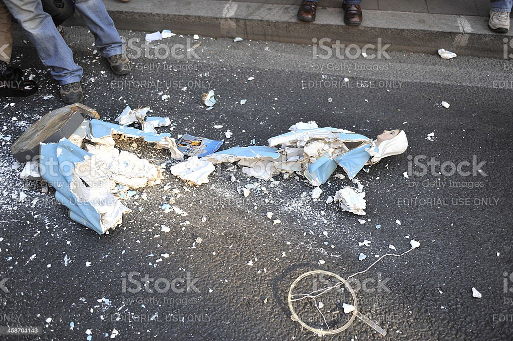 Virgin Mary destroyed in Roman Protest by rioters stock photo