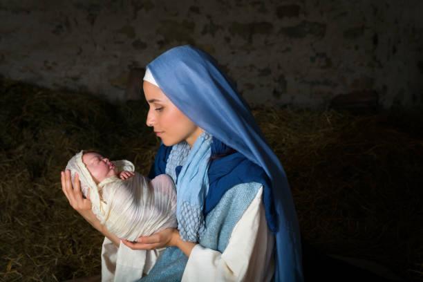 Virgin Mary holding baby Jesus stock photo