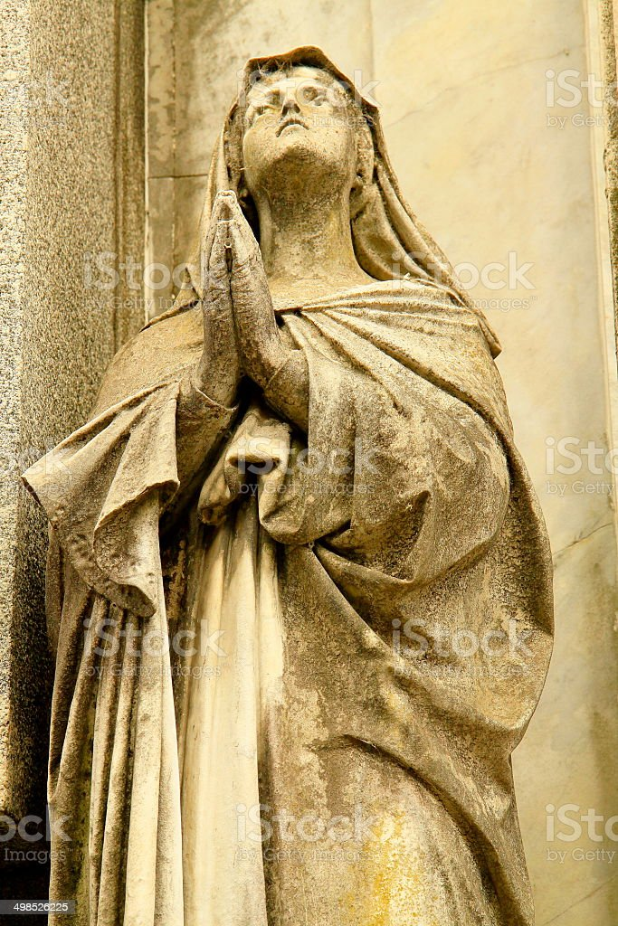 Virgin Mary praying and looking to the skies at Recoleta stock photo