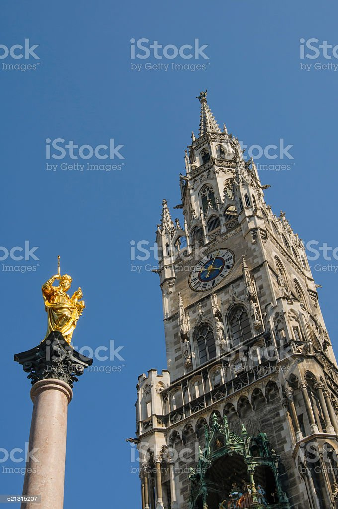 Virgin Mary statue and town hall tower in Munich, Germany stock photo