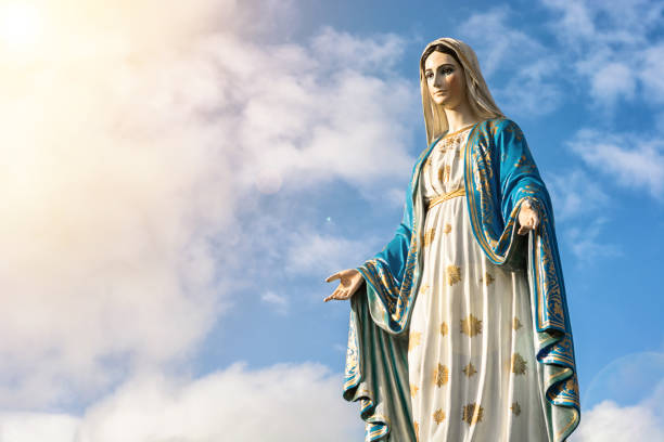 Virgin Mary statue with nice sky background Virgin Mary statue with nice sky background religious saint stock pictures, royalty-free photos & images