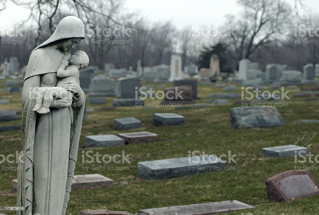Virgin Mary with Baby in Cemetary royalty-free stock photo