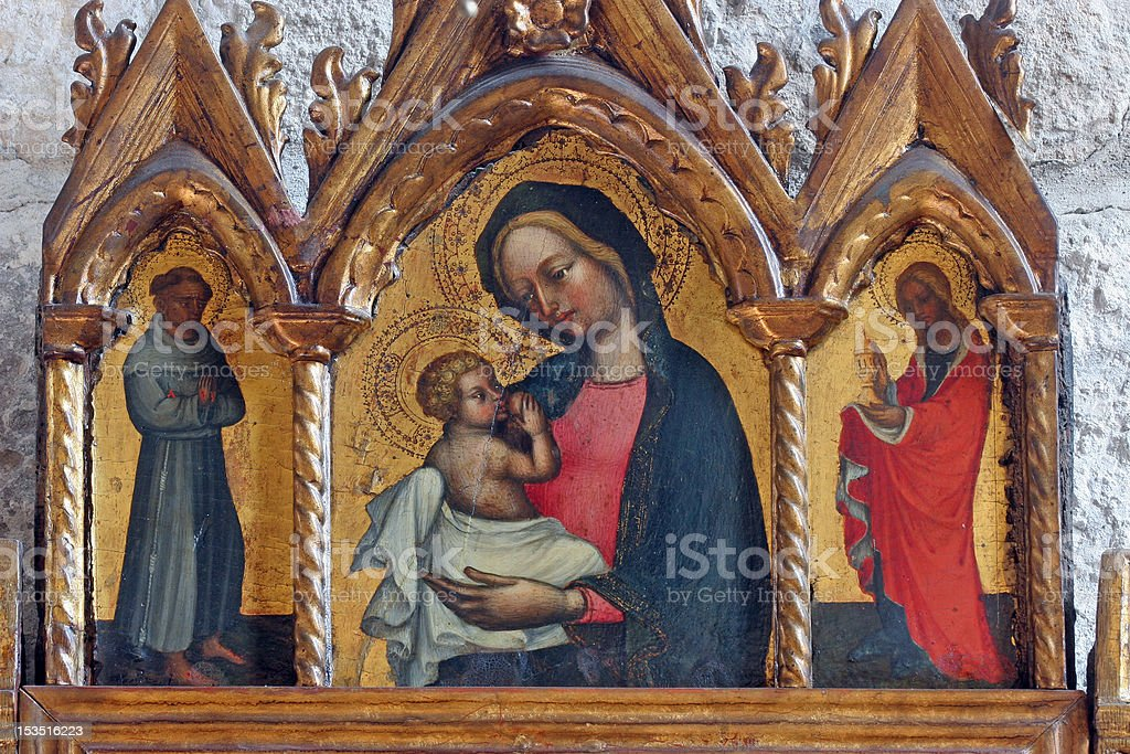 Virgin Mary with baby Jesus and Saints stock photo