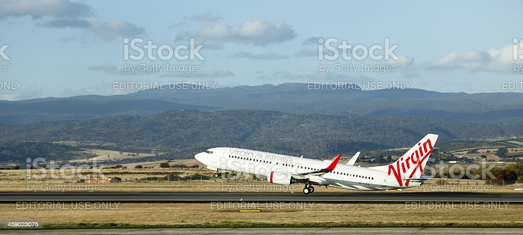 Virgin plane take-off from regional airport stock photo