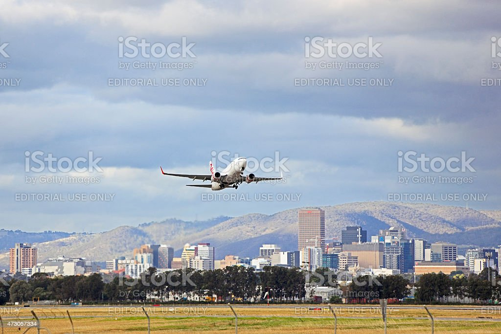 Virgin plane taking-off from Adelaide airport stock photo