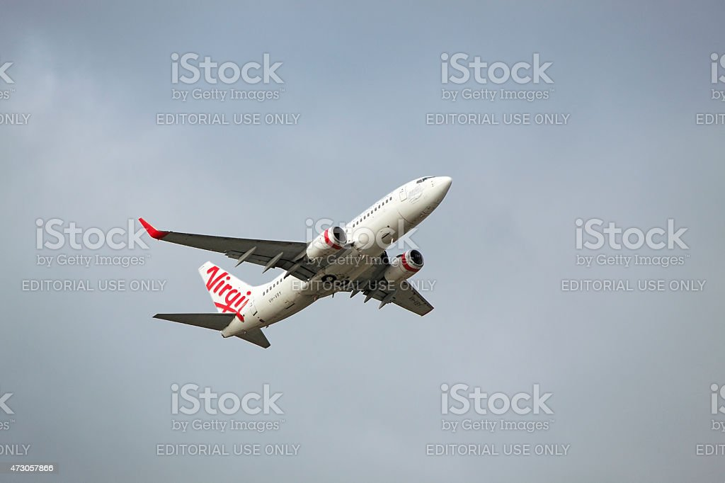 Virgin plane taking-off with grey overcast sky stock photo