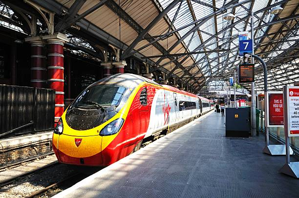 Virgin train in Lime Street Station, Liverpool. Liverpool, United Kingdom - June 11, 2015: Virgin Class 390 train alongside platform seven in Lime Street Railway Station, Liverpool, Merseyside, England, UK, Western Europe. electric train stock pictures, royalty-free photos & images