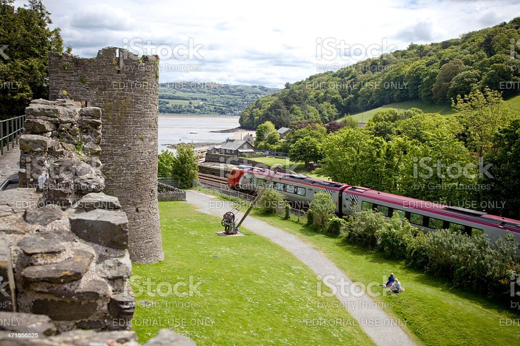 Virgin Voyager Train Passes Conwy Castle stock photo