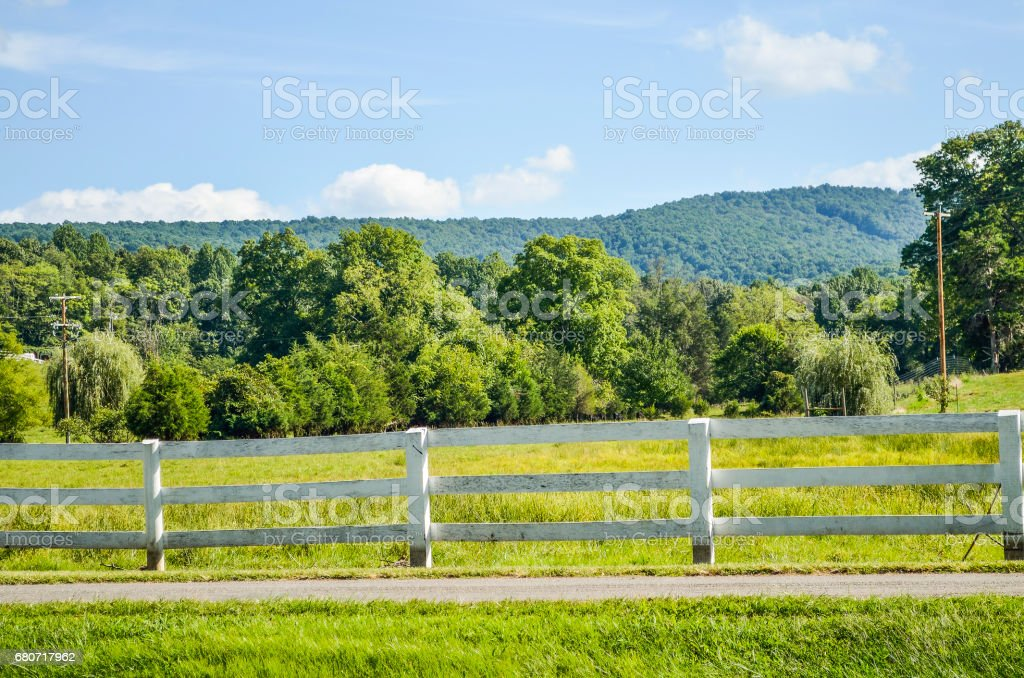 Virginia countryside in summer with fence and farms stock photo
