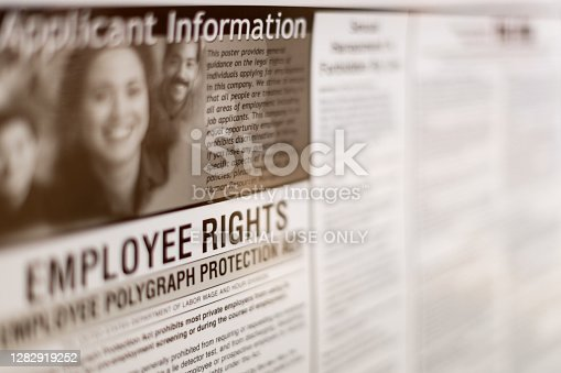 Fairfax, USA - September 29, 2018: Job employee rights applicant information regulations sign on board post poster information in Virginia office