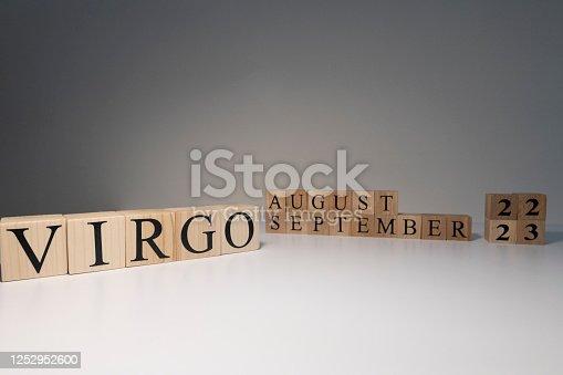 810006098 istock photo Virgo word on wooden cubes on white background. 1252952600