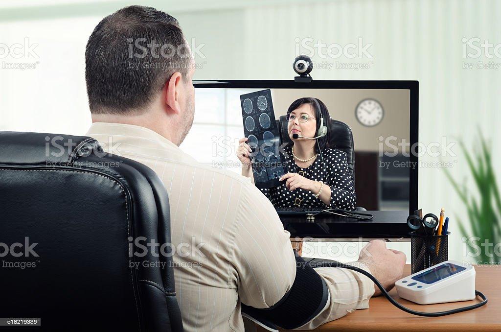 Virtual doctor measures blood pressure stock photo