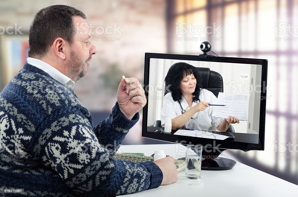 Virtual doctor shows blood pressure report to patient stock photo