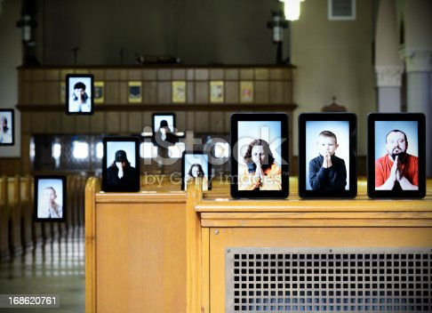 Concept of virtual church, people displayed on digital tablet inside of the church, some noise was added for gradient uniformity.