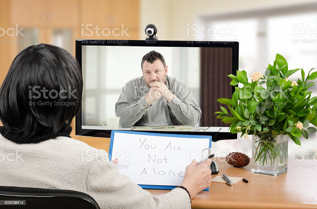 Virtual psychotherapist helps depressed man stock photo