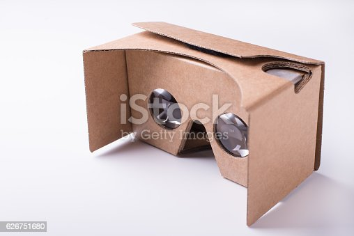 istock DIY virtual reality cardboard headset over white background 626751680