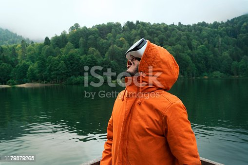 Orange raincoat play game nature