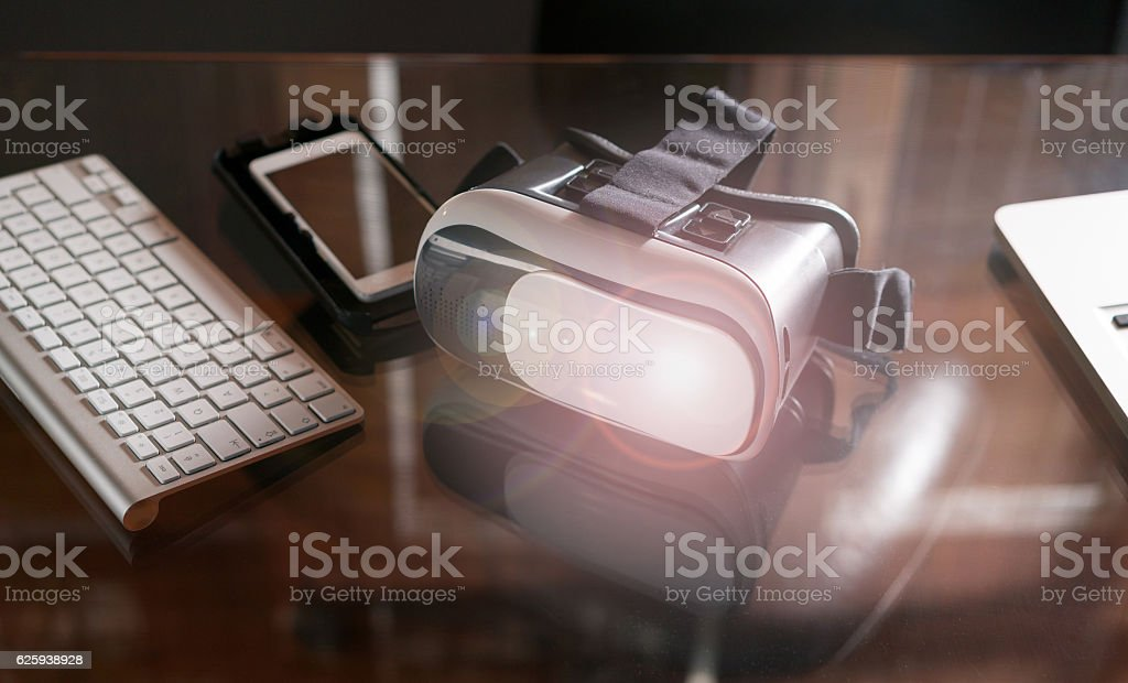 Virtual reality glasses Virtual reality goggles on the table stock photo