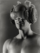 istock Virtual reality goggles and futuristic man 524534780