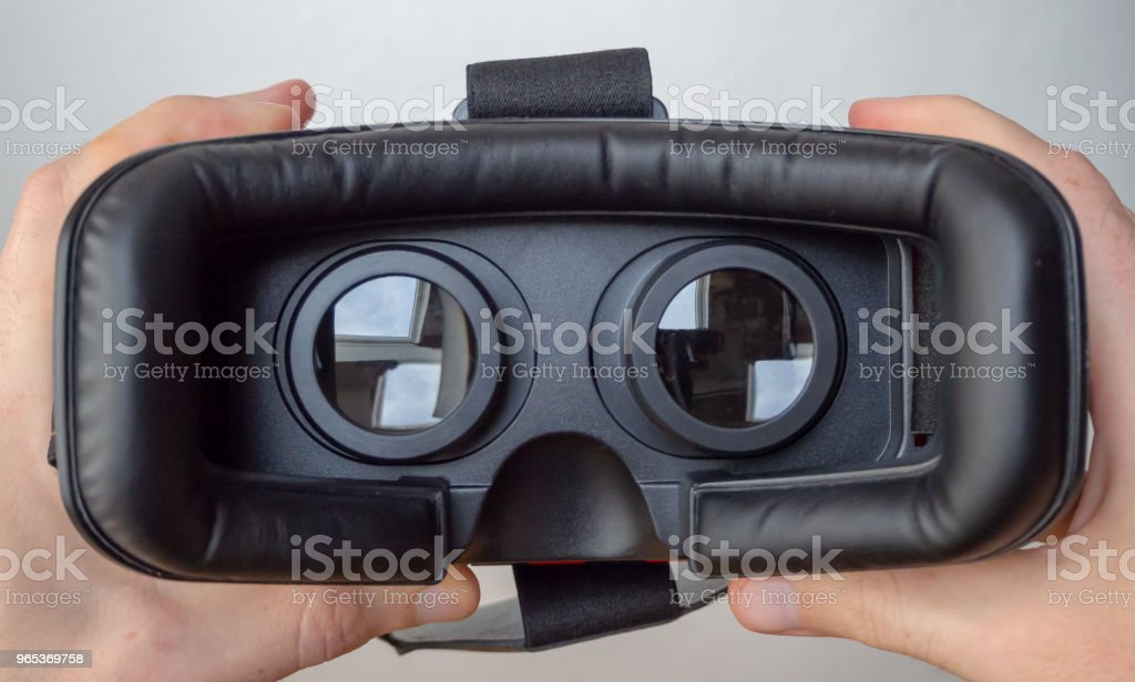 3D virtual reality headset being put on royalty-free stock photo