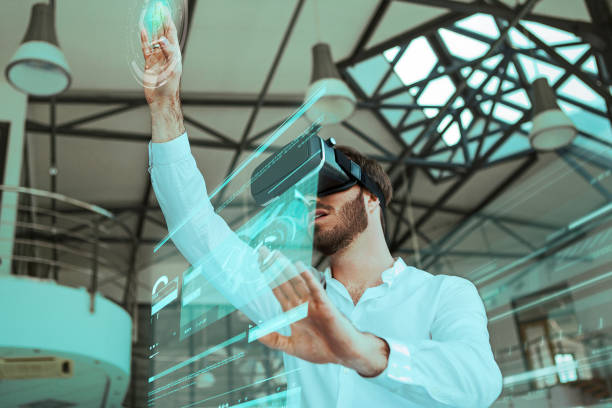 virtual reality in a workspace - augmented reality stock photos and pictures