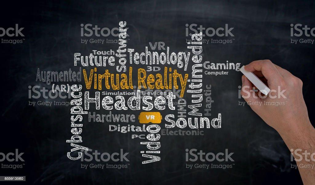 Virtual reality is written by hand on blackboard stock photo