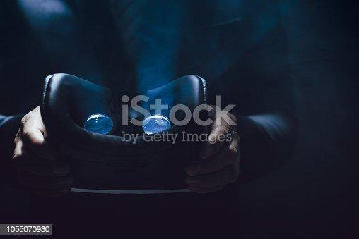 Man holding virtual reality glasses