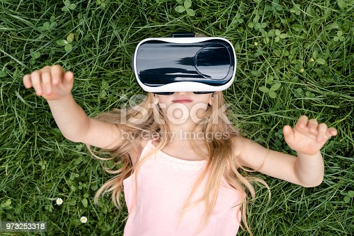 Little girl wearing Virtual reality glasses