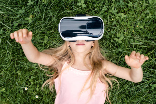 Virtual Reality Little girl wearing Virtual reality glasses digital native stock pictures, royalty-free photos & images