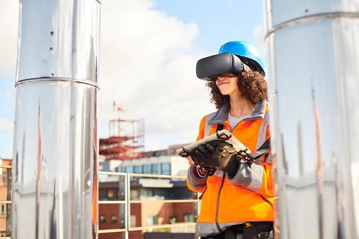 female architect uses simulator on construction rooftop