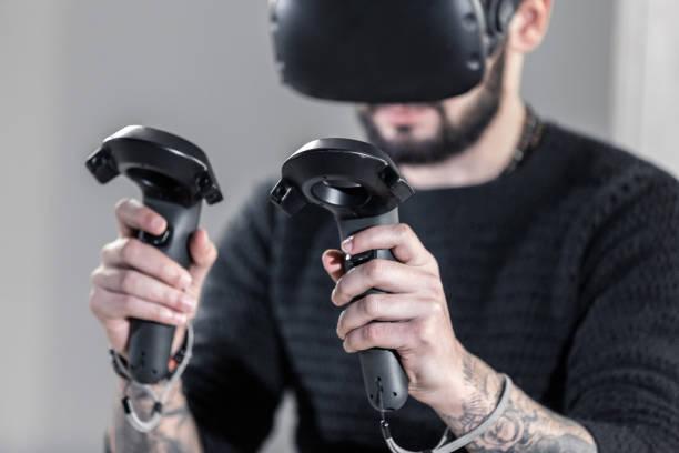 virtual simulator boxing - man joystick imagens e fotografias de stock