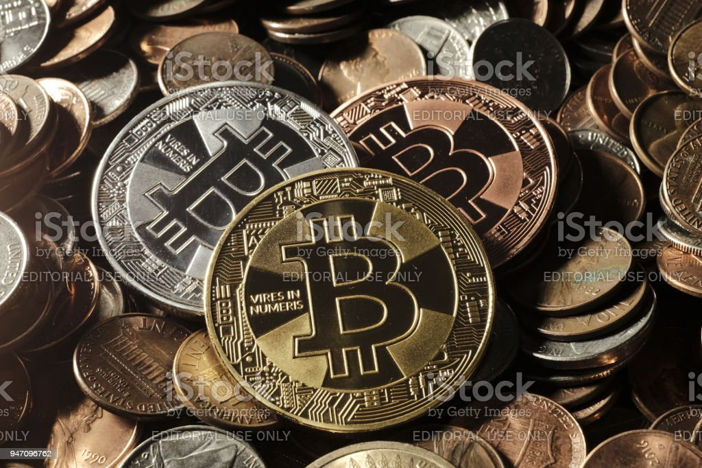 Virtuals coins and Bitcoin featured on top of dollar coins stock photo